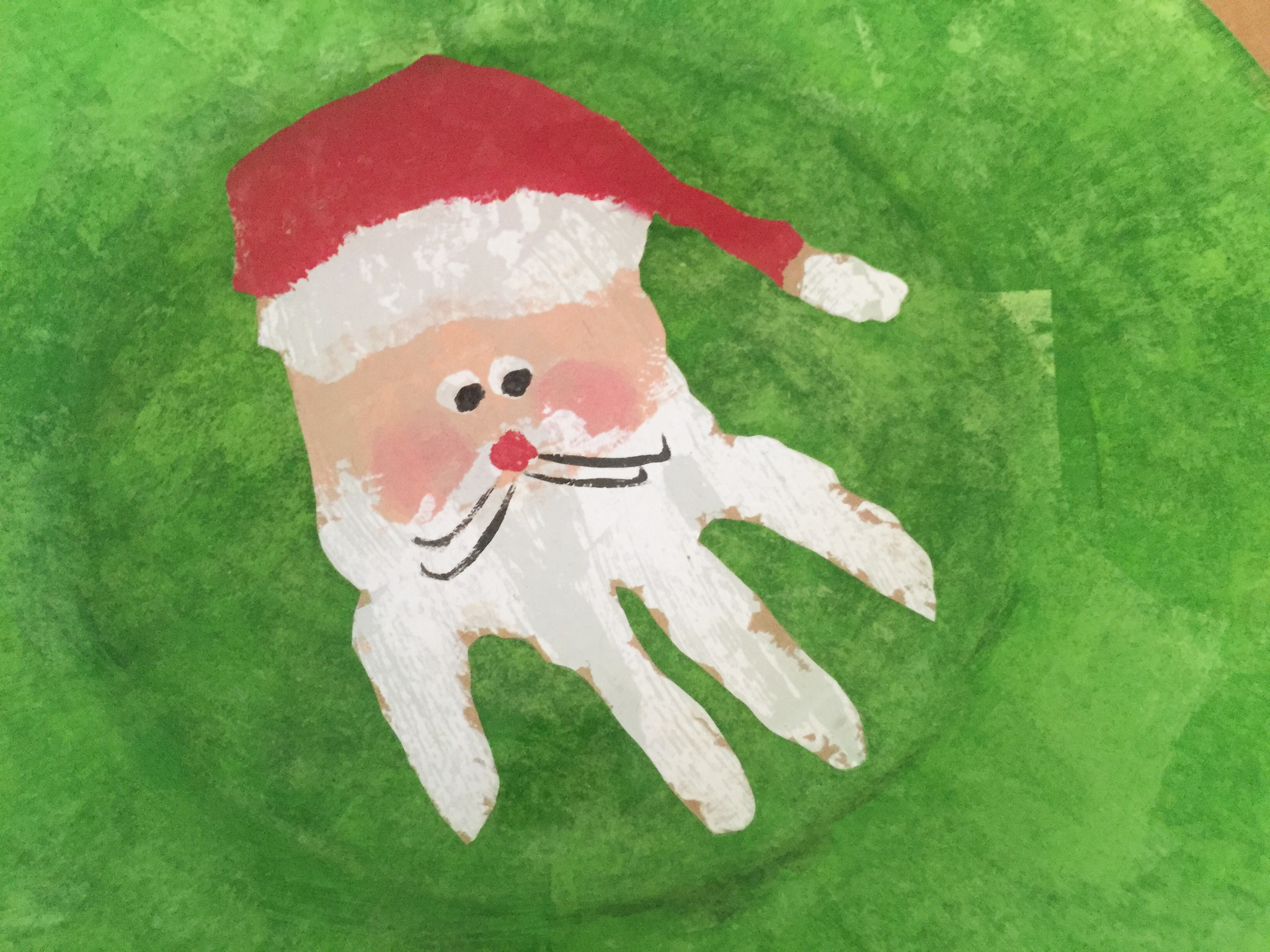 santa kids hand on plate close up